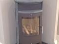 Apollo stove installation oin hearth.jpg
